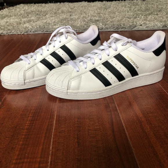 Adidas Superstar size 8. White with black stripes.